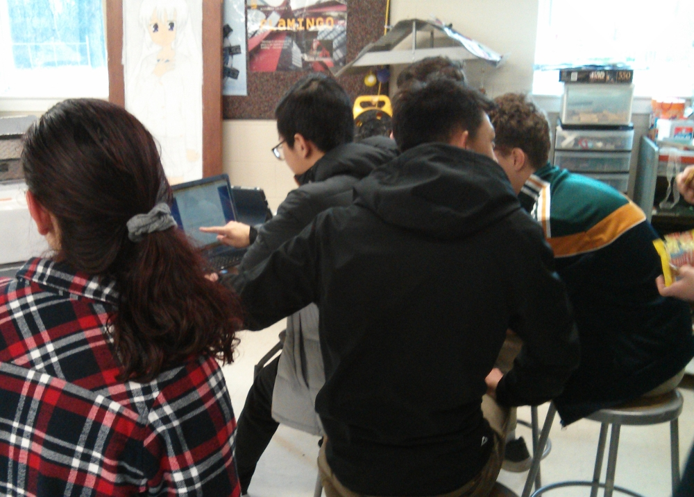 A group of us coding the robot